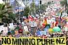 Thousands march up Queen St to demonstrate against Government mining plans. Photo / NZPA