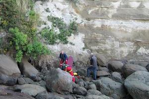 Westpac Helicopter rescue crew attend to the golfer who fell over the cliff. Photo / Supplied