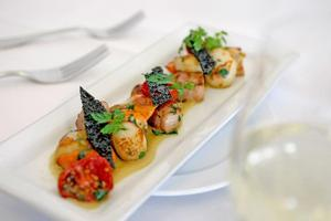 Pan-fried scallops with bacon provided the perfect starter at Soul. Photo / Stephen McNicholl