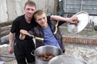 Two of the kids from Living Hope in Vladivostok help cook dinner. Photo / Rob Gray