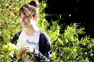 Children's clothing designer Isabelle Olson photographed in her garden. Photo / Babiche Martens