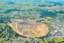 From the air the vast open pit of the Martha mine dominates the town of Waihi. Photo / Supplied