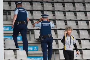 Tournament director Brenda Perry waits as police check the stands after an unattended bag was found. Photo / Brett Phibbs