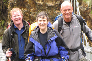 Helen Clark with MPs Darren Hughes (left) and Chris Carter. Photo / Otago Daily Times