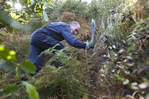 Police are clearing scrub near where Emma Campbell's car came to rest in an effort to find her body. Photo / Simon Baker