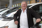 Used car salesman Pat Baker, owner of El Cheapo Cars, on the yard at Petone, Lower Hutt. Photo / Mark Mitchell