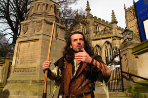 Leading a tour of Nottingham, actor Ade Andrews, dressed as Robin Hood, pauses at the gates of St. Maryís Church. Photo / Supplied