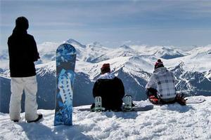 Snowboarders take in the view from the top of Whistler Blackcomb. Photo / Sarah Ivey
