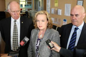 Department of Corrections Chief Executive Barry Matthews, Minister of Corrections Judith Collins, and Prison Services Manager Harry Hawthorn at a press conference following the death of prison guard Jason Palmer. Photo / NZPA