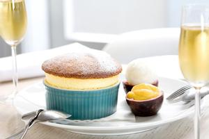 The passionfruit souffle for two with lemon sorbet and passionfruit curd. Photo / Babiche Martens