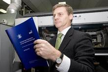 Finance Minister Bill English viewing a copy of the 2010 Budget. Photo / Mark Mitchell