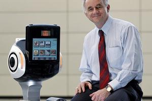 Dr Bruce MacDonald with a healthbot which can respond to a range of patient needs. Photo / Sarah Ivey