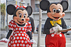 Mickey and Minnie Mouse receive a traditional welcome from Piripi Menary of Te Puru o Tamaki. Photo / NZPA