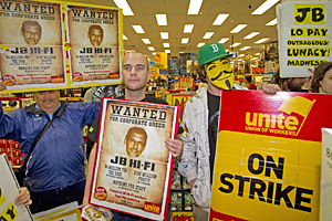 Protesters inside JB Hi-Fi's Albany store. Photo / NZPA