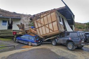 A building slipped and crushed cars at the Otago Youth Adventure Trust in the Berwick Forrest, Dunedin. Photo / Gerard Johnson