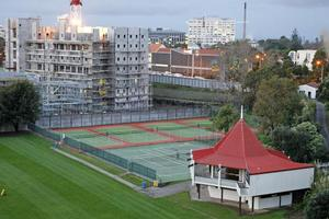 Auckland Grammar is worried about the impact of the new building (rear) on its sports facilities. Photo / Steven McNicholl