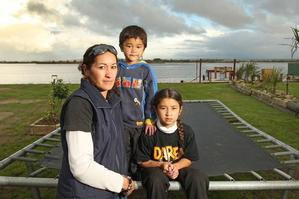Residents such as Rachael Thomas, here with her children Jason and Tessa, have been told they have to leave their homes in Little Waihi. Photo / Alan Gibson