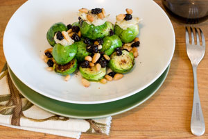 Brussels sprouts with roasted garlic and pinenuts. Photo / Greg Bowker