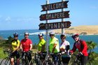 The cycling group gathers at the entrance to Hokianga Harbour after a thrilling ride through Waipoua Forest. Photo / Margie Elley-Brown