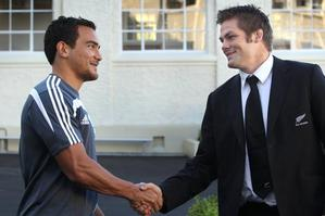 New All Blacks player Benson Stanley, left, is congratulated by captain Richie McCaw after the naming of the All Blacks squad. Photo / Brett Phibbs