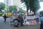 Japanese pro-whaling protesters outside court during Kiwi anti-whaling activist's trial.
