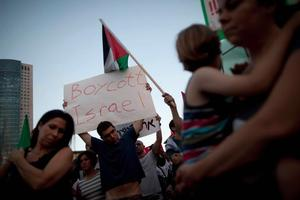 Protesters demonstrate against Israel's deadly raid on an aid flotilla bound for the blockaded Gaza Strip. Photo / AP