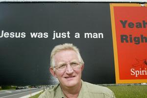 Rev Jim Wallace and the Bethlehem Community Church Centre billboard. Photo / Bay of Plenty Times