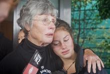 Hawea Vercoe's mother Rosalind comforts his daughter Moerangi. Photo / Christine Cornege 