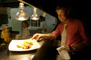 Jeremy Turner prepares to deliver a plate from the Cibo kitchen. Photo / Steven McNicholl