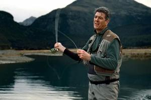 Telecom CEO Paul Reynolds appears fishing near Glenorchy in an ad promoting XT as the 'anywhere' network. Photo / Supplied