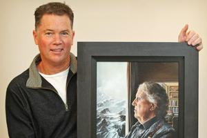 Craig Primrose with his favourite Edmund Hillary portrait. Photo / Greg Bowker