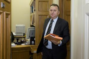 Shanes Jones clutches credit card statements which will kill his political career. Photo / Mark Mitchell