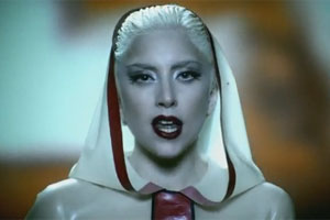 Lady Gaga's new video features chiselled topless blokes and latex-clad nuns.