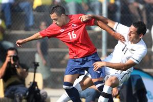 Leo Bertos (right) battles it out with Chile's Fabian Orellana, during their practice match. Photo / Brett Phibbs