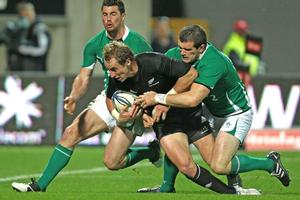 Jimmy Cowan of the All Blacks scores his second try against Ireland. Photo / Getty Images