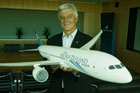 Norm Thompson, deputy CEO of Air New Zealand, with a model Boeing 787 Dreamliner. Photo / Supplied