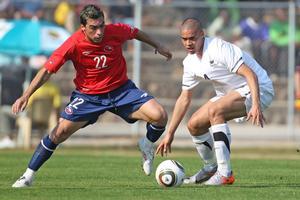 All Whites defender Winston Reid in action against Chile's Esteban Paredes. Photo / Brett Phibbs