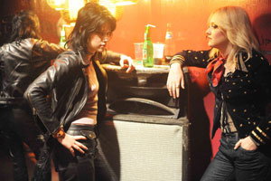 The Runaways is about the band of the same name which launched the career of Joan Jett (played by Kristen Stewart, far left). Photo / Supplied