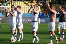 The All Whites applaud the crowd after their 1-1 draw with Slovakia. Photo / Brett Phibbs