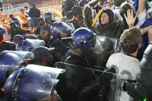 The riot police force the New Zealand fans out of the Peter Mokaba Stadium. Photo / Brett Phibbs