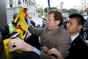 Green Party co-leader Russel Norman is restrained during the scuffle with Chinese security over his Tibetan flag. Photo / Mark Mitchell