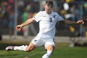 All Whites striker Shane Smeltz in action against Chile. Photo / Brett Phibbs