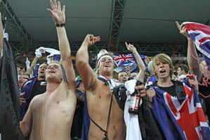 All Whites fans go wild after the World Cup draw against Italy in Nelspruit. Photo / Brett Phibbs