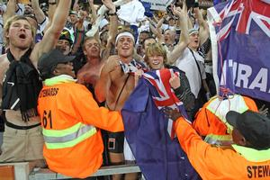 All Whites fans in South Africa celebrate this morning's shock World Cup draw against Italy. Photo / Brett Phibbs