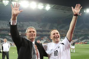 Coach Ricki Herbert and John Key celebrate this week's draw with Italy at the World Cup. Photo / Brett Phibbs