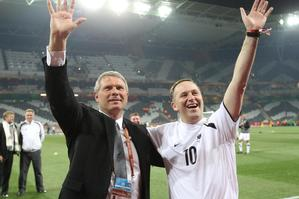 All Whites coach Ricki Herbert and John Key share a moment at the World Cup. Photo / Brett Phibbs