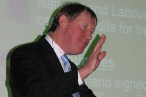 Nick Smith endeavours to placate a lively audience over government's ETS in Blenheim last night. Photo / Tony Orman