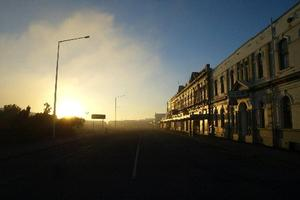 Sunrise hits the main street of Bluff. Photo / Dean Purcell