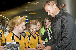 All White Mark Paston is greeted by fans at Auckland Airport. Photo / Paul Estcourt
