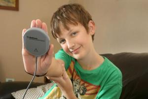 A magnet-like scanner transmits data from Zachary Lutter's pacemaker over the phone to his doctor in Auckland. Photo / Supplied